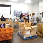 Donations from corporate partners were collected and sorted.