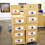 Volunteers prepped boxes to be distributed citywide.