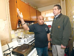 Gov. Andrew Cuomo toured the home of Carmen Silva with her son Alberto Pizarro. Photo: Office of the Governor