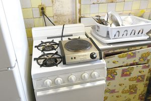 A hot plate stands in for the broken stove. Photo: Office of the Governor