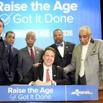 The legislation was signed on April 10th by Governor Andrew Cuomo (center).