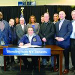 Governor Andrew Cuomo (center) signed the order in East Harlem. Photo: Office of the Governor