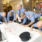 Firefighters sign up during a donation drive.