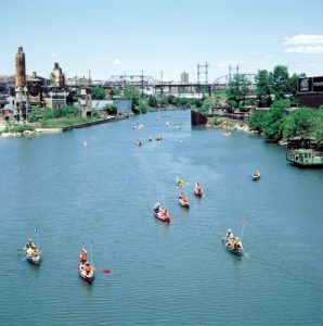 Paddle along the river.
