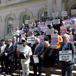 Workers rallied at City Hall.