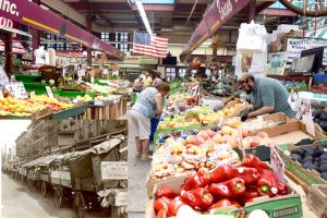 The market was opened in 1940. To the bottom left are pushcarts lined on Arthur Avenue.