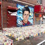 """Un mural marca el sitio de la muerte de Lesandro """"Junior"""" Guzmán-Feliz."""