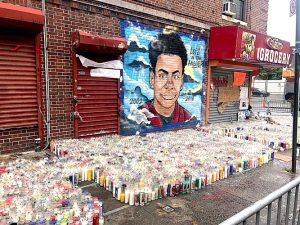 "A mural marks the site of Lesandro ""Junior"" Guzmán-Feliz's death."