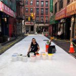 Artist Chen Dongfan at work in Chinatown. Photo: NYC DOT