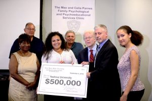 Assemblymember Nathalia Fernández (center) has allocated $500,000 in funding to the Parnes Clinic.