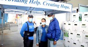 Catholic Charities staffers Rolando Rodriguez, Corina Pintor and Antonio Fernandez